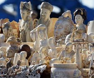 This Nov. 14, 2013 file photo shows confiscated decorative ivory piled together in preparation to be destroyed during an event at the National Wildlife Property Repository  in Commerce City, Colo.