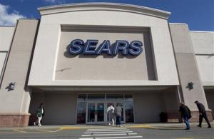 In this Feb. 22, 2012 file photo, shoppers enter a Sears department store location in Dedham, Mass.  Sears Holdings  reports quarterly earnings on Thursday, Nov. 21, 2013.
