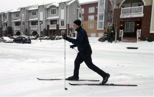 Peter Phillips uses his cross-country skies to navigate the frozen streets in Charlotte, North Carolina.