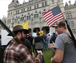 Timothy Coley, left,  of Bristol Conn. and Josephy Boniface of East Granby Conn. talk during a gun rights rally at the Connecticut State Capitol in Hartford Conn. on Saturday April 20, 2013.
