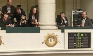 Journalists look at the electronic voting board as Belgian politicians vote in favor of the bill on child euthanasia.