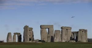 Visitors take photographs of the world heritage site of Stonehenge, England, Tuesday, Dec. 17, 2013.