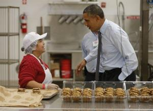 President Obama greets a baker at a Costco store in Lanham, Md. the morning after speaking about the minimum wage in his State of the Union address last month.