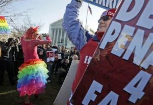 Qween Amar from Orlando, Fla., left, dances by Margie Phelps, right, a member of the Westboro Baptist Church, outside the Supreme Court in Washington, Tuesday, March 26, 2013, where the court will hear arguments on California's voter approved ban on same-sex marriage, Proposition 8.