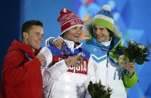 Men's snowboard parallel giant slalom medalists, from left, Switzerland's Nevin Galmarini, silver, Russia's Vic Wild, gold, and Slovenia's Zan Kosir, bronze, at the 2014 Winter Olympics in Sochi, Russia, Feb. 19, 2014.
