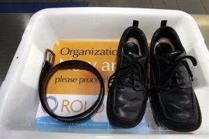 A belt and shoes sit in a tray at Los Angeles International Airport.