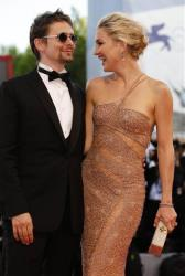 Kate Hudson and Matt Bellamy arrive for the premiere of the movie 'The Reluctant Fundamentalist' that opens the 69th edition of the Venice Film Festival in Venice, Italy, Wednesday, Aug. 29, 2012.