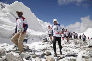 Participants of the Tenzing Hillary Everest Marathon begin their race at the Everest base camp in the Khumbu region of the Nepal Himalayas, Wednesday, May 29, 2013.