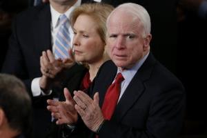 Kirsten Gillibrand and John McCain applaud President Obama's State of the Union address, Tuesday, Jan. 28, 2014.