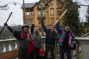 Protesters pose in front of the Yanukovichh's countryside residence yesterday.