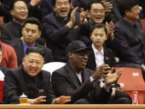 North Korean leader Kim Jong Un, left, and former NBA star Dennis Rodman watch North Korean and US players in an exhibition basketball game at an arena in Pyongyang, North Korea, Feb. 28, 2013.