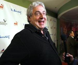 In this Dec. 12, 2009 file photo, actor and director Harold Ramis laughs as he walks the Red Carpet  to celebrate The Second City's 50th anniversary  in Chicago.