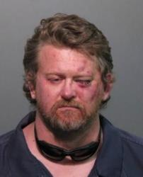 John Wayne Rogers, who has been legally blind since an accident in 2001, is seen in this booking photo.