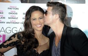 Paula Patton, left, and Robin Thicke arrive at the world premiere of Baggage Claim at the Premiere House at Regal Cinemas L.A. Live on Wednesday, Sept. 25, 2013 in Los Angeles.