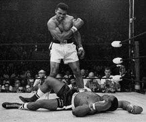 In this May 25, 1965, photo, heavyweight champion Muhammad Ali stands over fallen challenger Sonny Liston. This was the second of  their two fights.