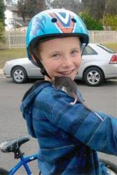 This undated photo released by Gomez Trial Attorneys  shows Aidan Pankey and one of his pet rats.
