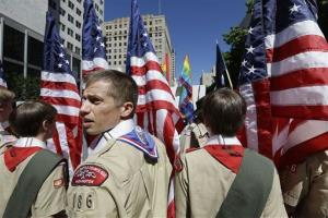 In this June 30, 2013 file photo, Boy Scouts from the Chief Seattle Council carry US flags as they prepare to march in the Gay Pride Parade in downtown Seattle.