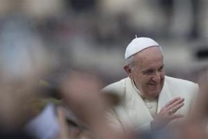 Pope Francis waves as he is driven through the crowd ahead of his weekly general audience in St. Peter's Square, at the Vatican, Wednesday, Feb. 26, 2014.