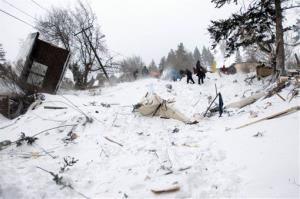 Rescuers dig at the scene of an avalanche in Missoula's Rattlesnake Valley on Friday, Feb. 28, 2014.