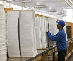 Printed copies of President Barack Obama's proposed budget plan for fiscal year 2014 are prepared for binding at the US Government Printing Office, April 8, 2013.