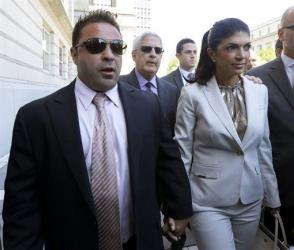 In this July 30, 2013 file photo, Giuseppe Joe Giudice, left, and his wife, Teresa Giudice, walk out of Martin Luther King Jr. Courthouse after an appearance in Newark, NJ.