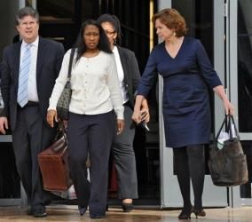Marissa Alexander, center, walks out of the Duval County Courthouse with her lawyers Bruce Zimet, left, and Faith Gay after a hearing on Friday Jan. 10, 2013 in Jacksonville, Fla.
