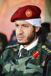 Saadi Gadhafi, son of the late Libyan leader Moammar Gadhafi, watches a military exercise months before the regime's downfall.