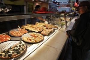 A customer looks at pizzas at a Sbarro restaurant in San Jose, Calif., Monday, April 4, 2011.