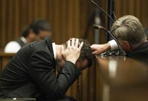 Oscar Pistorius, puts his hands to his head while listening to evidence from a witness speaking about the morning of the shooting of his girlfriend Reeva Steenkamp, Thursday, March 6, 2014.