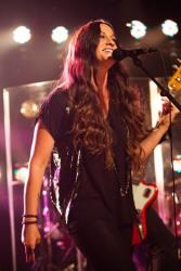 This Tuesday, Aug. 28, 2012, photo shows Alanis Morissette performing songs from her new album Havoc and Bright Lights at the iHeartRadio Theater presented by PC Richard & Son in New York.