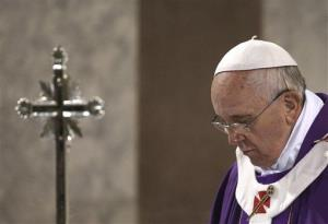Pope Francis celebrates the Ash Wednesday mass at the Santa Sabina Basilica in Rome, Wednesday, March 5, 2014.