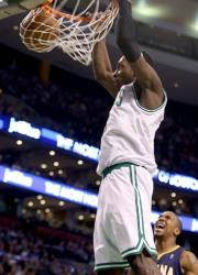 Boston Celtics small forward Jeff Green (8) dunks the ball during the second half of an NBA basketball game against the Indiana Pacers, Saturday, March 1, 2014, in Boston.