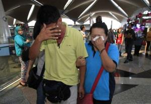 A woman wipes her tears at Kuala Lumpur International Airport.