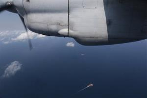 Ships are seen from a flying Soviet-made AN-26 of the Vietnam Air Force during a search operation for the missing Malaysia Airlines Boeing 777 over the South China Sea Monday, March 10, 2014.