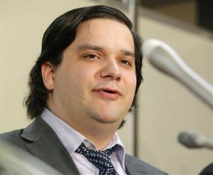 In this Feb. 28, 2014 file photo, Mt. Gox CEO Mark Karpeles speaks at the Justice Ministry in Tokyo.