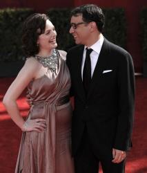 Elisabeth Moss, left, and Fred Armisen  arrive at the 61st Primetime Emmy Awards on Sunday, Sept. 20, 2009, in Los Angeles.
