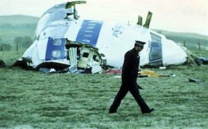 In this December 1988 file photo, a police officer walks past the wreckage in Lockerbie, Scotland, after the terrorist bombing killed 270 people.