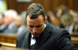 Oscar Pistorius sits in the dock during his trial in Pretoria, South Africa, yesterday.