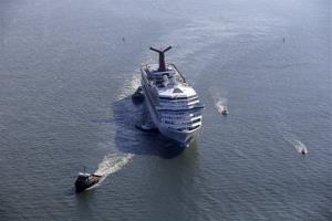 This Feb. 14, 2013 file photo shows the disabled Carnival Lines cruise ship Triumph being towed to harbor off Mobile Bay, Ala.