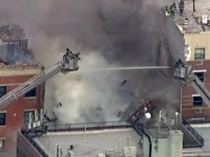 In this image taken from video from WABC, firefighters battle the fire in East Harlem.