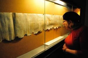 A woman looks at the Dead Sea Scrolls on display at the caves of Qumran on December 14 2008. The Dead Sea Scrolls were discovered in Qumran caves between the years 1947 and 1956.