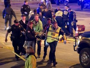 A patient is carried away after being struck by a vehicle on Red River Street in downtown Austin, Texas.