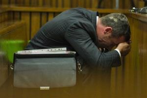 Oscar Pistorius puts his hands to his head as he listens to forensic evidence during his trial in court in Pretoria, South Africa, Thursday, March 13, 2014.