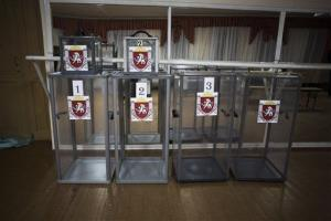 Ballot boxes with the coat of arms of Crimea are seen within a polling station in the municipality of Dobroe, near Simferopol, Ukraine yesterday.
