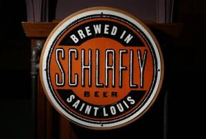 The logo seen on many bottles off beer produced by the brewery co-founded by Tom Schlafly is seen inside Schlafly Bottleworks on Wednesday, March 12, 2014, in Maplewood, Mo.