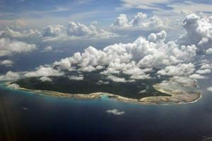 In this file photo, clouds hang over the North Sentinel Island, in India's southeastern Andaman and Nicobar Islands.