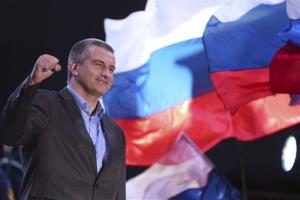 Crimea's Russia-backed leader Sergei Aksyonov gestures as people celebrate in Lenin Square in downtown Simferopol last night.