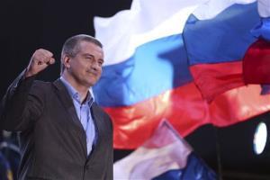 Crimea's Russia-backed leader Sergei Aksyonov gestures as people celebrate in Lenin Square in downtown Simferopol last night.
