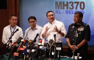 Malaysia's acting minister of transport Hishamuddin Hussein, second from right, speaks during a press conference yesterday.