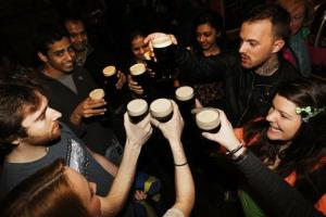 Patrons enjoy pints of Guinness Stout as New Yorkers celebrate St. Patrick's Day.